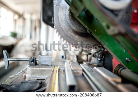 close-up of industrial metal cutting tool. Sliding compound mitre saw or industrial saw in steel and metal production factory - stock photo