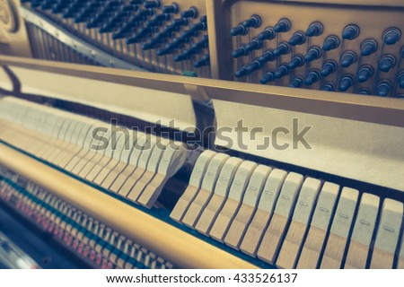 Close up of Inside the piano with selective focus Close up of Inside the piano ,Filtered image processed vintage effect. - stock photo