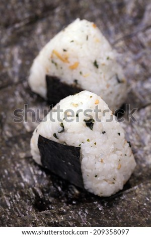 Close up of Japanese rice ball (onigiri) on seaweed. - stock photo