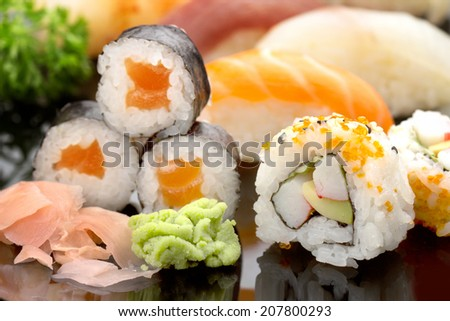 close up of japanese sushi on black glass dish - stock photo