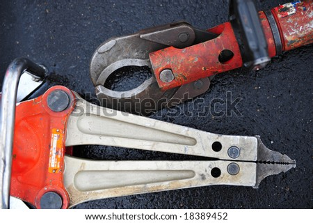 Close up of jaws of life and cutting tool used by rescue personnel to cut and bend metal - stock photo