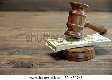 Close-up Of Judges Gavel, Soundboard And Bundle Of Dollar Cash On The Rough Wooden Table. Concept For Corruption, Bankruptcy Court, Bail, Business Or Financial Crime, Bribing, Fraud, Auction Bidding - stock photo