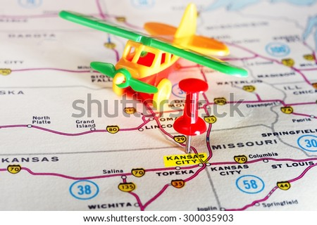 Close up of Kansan City USA  map with red pin and airplane toy  - Travel concept - stock photo