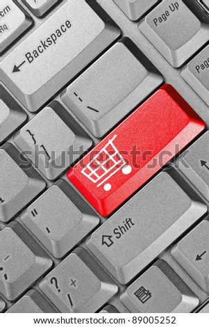 close up of keyboard with shopping cart on a button - stock photo