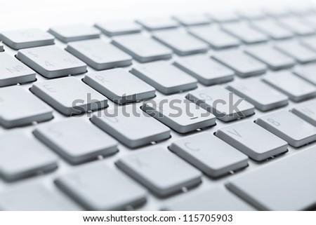 Close up of keys of light laptop keyboard - stock photo