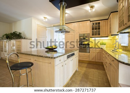 Close-up of kitchen island in designed kitchen - stock photo