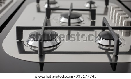 Close up of kitchen range of a new kitchen - stock photo