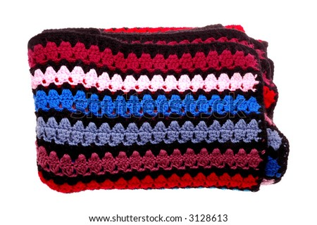 Close up of knitted quilt of many colors - stock photo