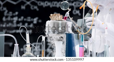 close-up of laboratory tools and chemical reactions in a chemistry lab - stock photo