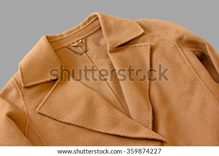 Close-up of lapel of wool coat on gray background. - stock photo