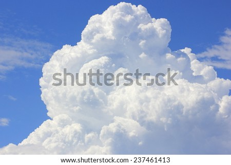 Close up of large fluffy clouds in blue sky - stock photo