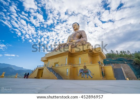 close-up of largest gilded Buddha and the amazing bronze statue of buddha in the capital city of thimphu in isolated kingdom of bhutan - stock photo