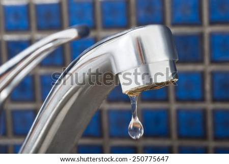 Close-up Of Leakage Tap With Dripping Water Drop - stock photo