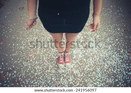 close up of legs women and confetti outdoor - stock photo