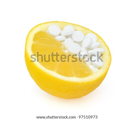 Close up of lemon and pills isolated - vitamin concept - stock photo