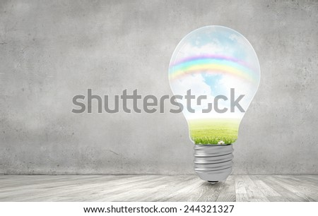 Close up of light bulb and ecology concept in it - stock photo
