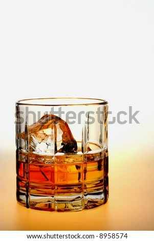 Close-up of liquor and ice in glasses on a white background. - stock photo