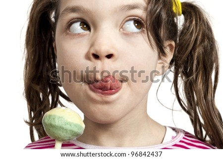 Close-up of little girl with a lollipop, isolated on white background - stock photo