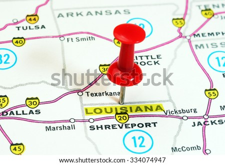 Close up of  Louisiana state USA  map with red pin - Travel concept - stock photo
