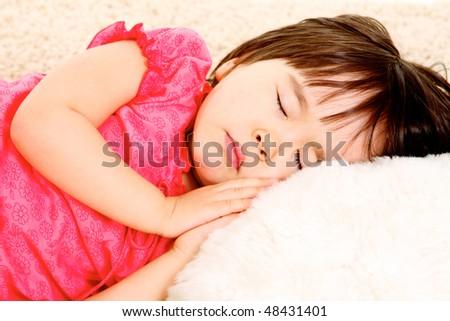 Close-up of lovely little girl sleeping - stock photo