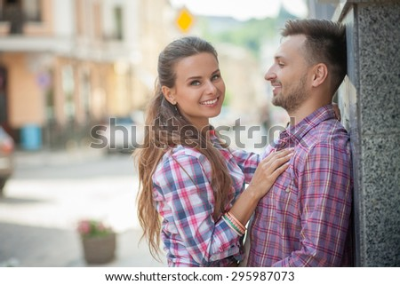 Close-up of loving couple in the city. Man and woman smiling and enjoying their time spending. - stock photo