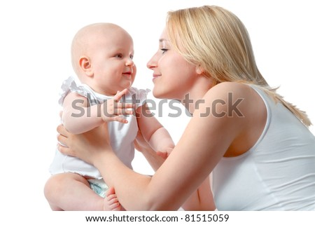 Close up of loving mother and her baby - stock photo