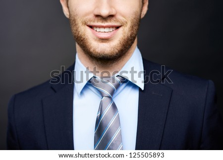 Close-up of lower face part of smiling businessman - stock photo