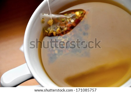 Close up of luxury tea bag in cup - stock photo