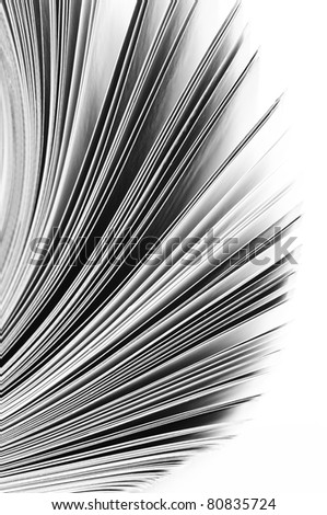 Close-up of magazine pages on white background. B&W image. Shallow DOF, focus on edges. - stock photo