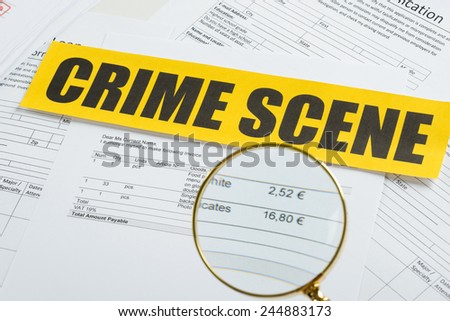 Close-up Of Magnifying Glass Over Documents With Crime Scene Yellow Tape - stock photo