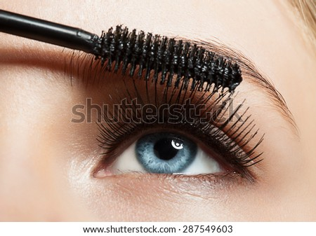 Close-up of make-up blue eye with long lashes with black mascara - stock photo