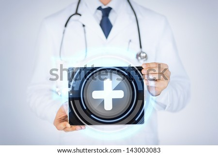 close up of male doctor holding tablet pc with medical app - stock photo