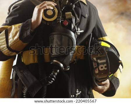 Close up of male fire fighter - stock photo