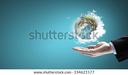 Close up of male hand holding our Earth planet. Elements of this image are furnished by NASA - stock photo