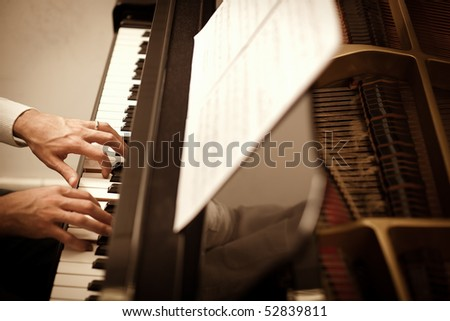 close up of male hands playing piano. Horizontal shape, high angle view - stock photo