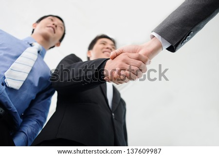 Close-up of male handshaking at the office - stock photo