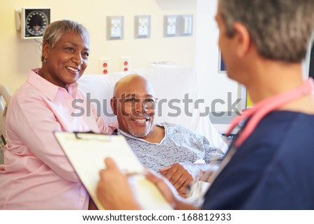 Close Up Of Male Nurse Updating Patient Notes - stock photo