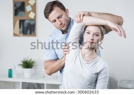 Close-up of male physiotherapist training with patient - stock photo