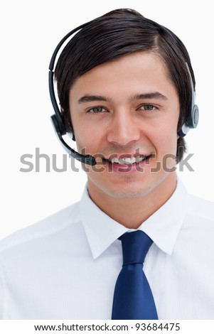 Close up of male telephone support employee with headset on against a white background - stock photo