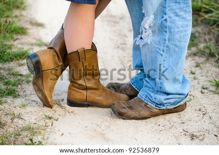 Close up of man and woman with boots and shoes - stock photo