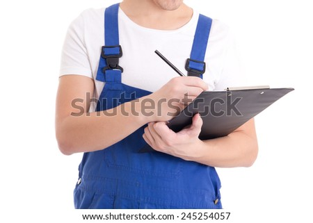 close up of man builder in blue uniform writing something in clipboard isolated on white background - stock photo