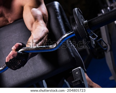 Close up of man hand during biceps exercise - stock photo