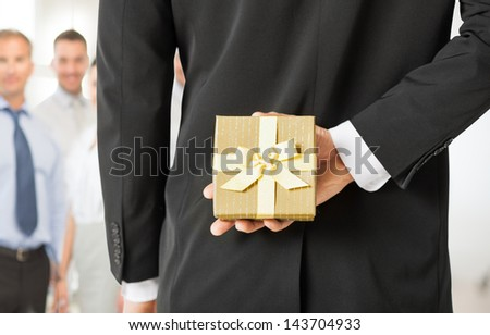 close up of man hands holding gift box in office - stock photo