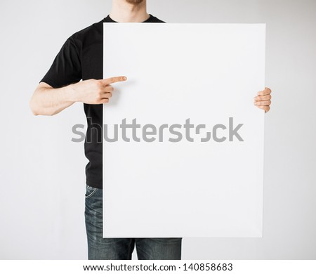 close up of man hands showing white blank board - stock photo
