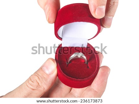 Close up of man holding engagement ring and gift box - stock photo