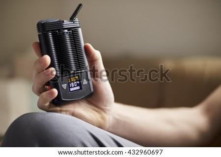 Close Up Of Man Holding Vapourizer - stock photo