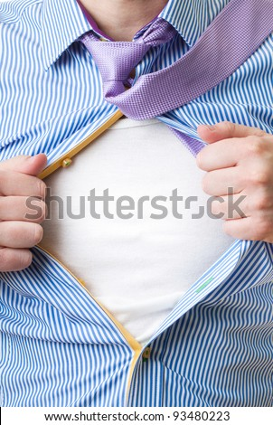 Close-up of man opening his shirt to reveal blank white shirt like superman - stock photo