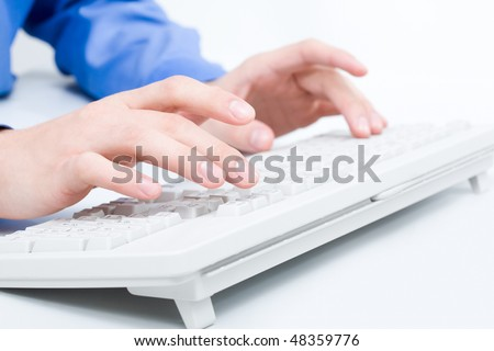 Close-up of man?s hands touching keys of computer keyboard - stock photo