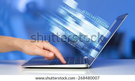 Close up of man typing on laptop computer with glowing technology effect - stock photo
