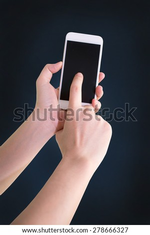 Close up of man using mobile smart phone - stock photo